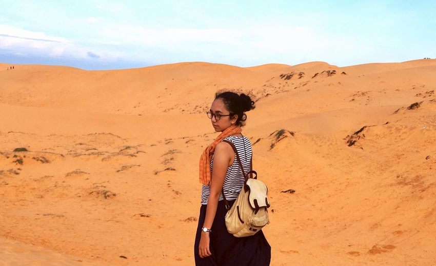 A pose at the Red Sand Dune, Mui Ne - Vietnam EyeEm Selects Sand Dunes Vietnam Travel Destinations Travel Traveling One Person Young Adult Young Women Landscape Beauty In Nature Real People Sand Dune Outdoors Nature Desert Standing Sky Day Arid Climate Casual Clothing Scenics People