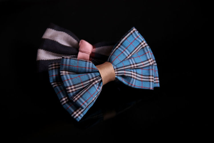 Close-Up Of Tied Bow Over Black Background