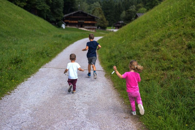 EyeEm Selects Sound Of Life Nikond750 Three People Childhood Child Walking Togetherness Running Casual Clothing The Way Forward Boys Girl Twins Toddler  Teenager Leisure Activity Austria Tirol  Alps Full Length Travel Photography Holiday Kids Being Kids Kidsphotography