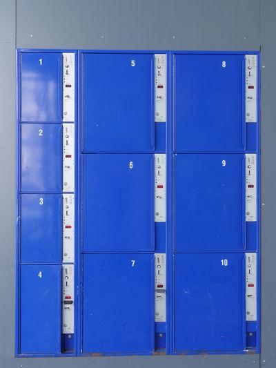 Close-up of blue lockers