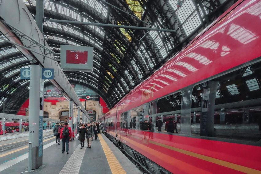 Red stripes Group Of People Transportation Architecture Real People Built Structure Large Group Of People City Crowd Men Public Transportation Mode Of Transportation Rail Transportation Sign Railroad Station Platform Women Railroad Station Incidental People Direction Travel Day