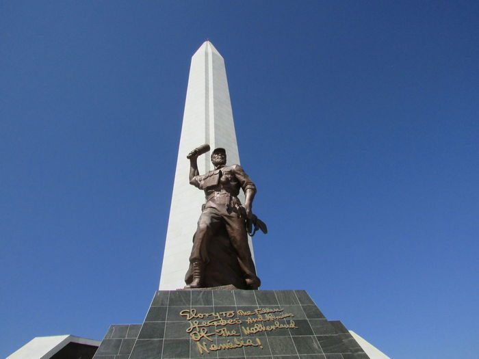 Low Angle View Clear Sky Blue History Outdoors Day High Section Tall - High Spire  No People Steeple Famous Place heroes acre namibia Windhoek Namibia Clear Sky Architecture Built Structure War Warmemorial Swapo Namibianwarmemorial Liberation Liberation In Africa