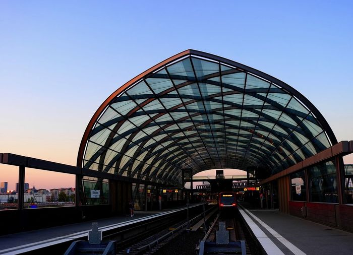 Railroad station platform against clear sky