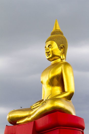 Day Gold Colored Golden Color Human Representation Idol Low Angle View Male Likeness No People Outdoors Religion Sculpture Sky Spirituality Statue