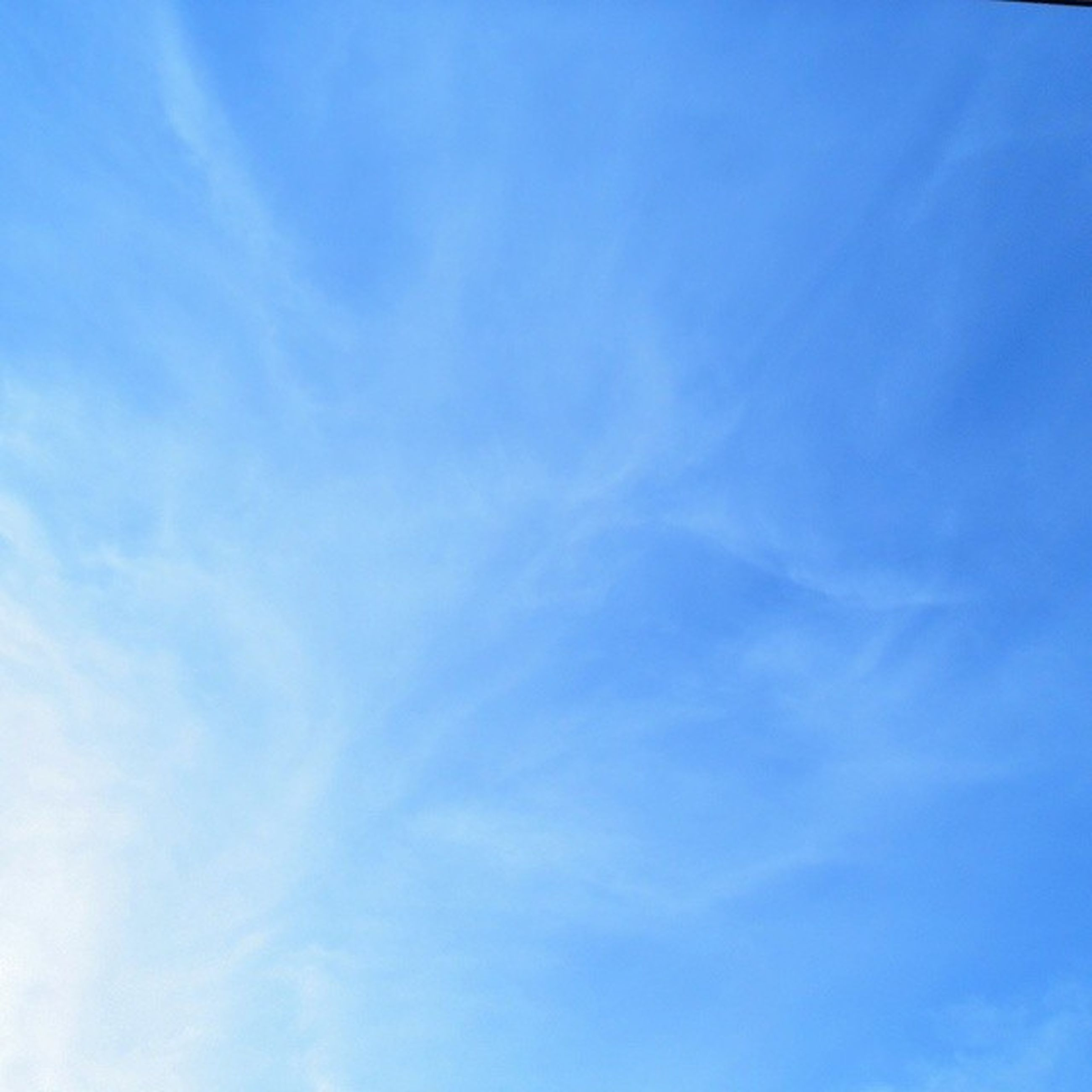 blue, low angle view, sky, tranquility, beauty in nature, scenics, nature, tranquil scene, cloud - sky, cloud, day, sky only, white color, idyllic, outdoors, copy space, backgrounds, no people, cloudscape, white