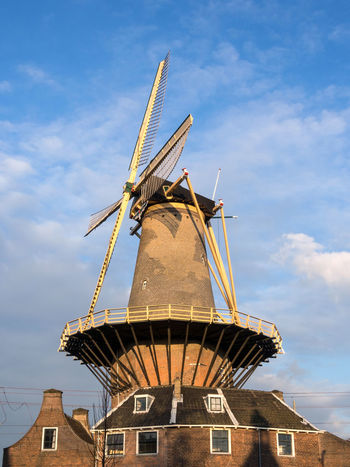 Typical dutch windmill in the city of Delft, the Netherlands Delft Netherlands Alternative Energy Architecture Blue Sky Building Exterior Built Structure Clouds Day Environmental Conservation Europe Holland Low Angle View Mill No People Old Outdoors Renewable Energy Traditional Windmill Wicks Wind Power Windmill
