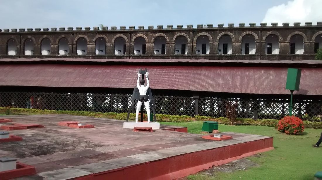 Built Structure Architecture Building Exterior Outdoors No People Flower Day Tree Sky Nature Andaman & Nicobar Islands Kalapani CellularJail Hanging Statue Garden Metal Jail View Sky National Memorial Famous Place Pattern, Texture, Shape And Form