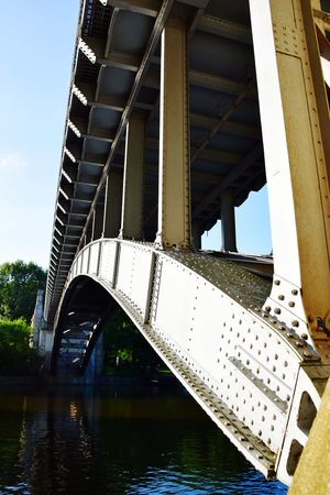Nature Beauty In Nature Sunlight Sunshine ☀ Day Outdoors Focus On Foreground Water Underneath City Bridge - Man Made Structure River Architecture Sky Built Structure Railway Bridge Under Arch Bridge