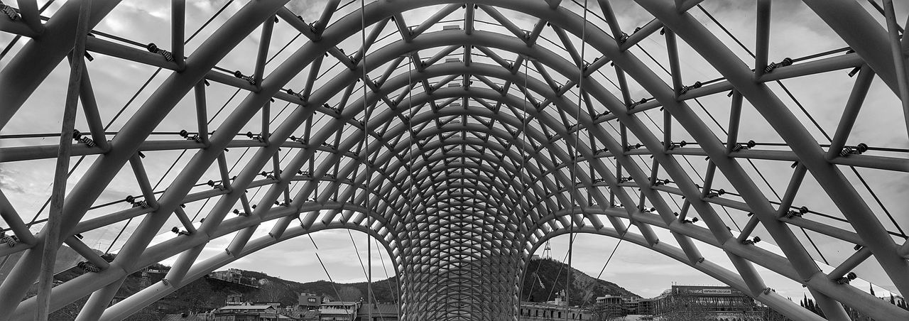 Under the Iron Sky Bridge - Man Made Structure Bw Bw_collection BW_photography Blackandwhite Blackandwhite Photography Low Angle View Built Structure Architecture No People Sky Full Frame Pattern Day Travel Destinations City The Graphic City