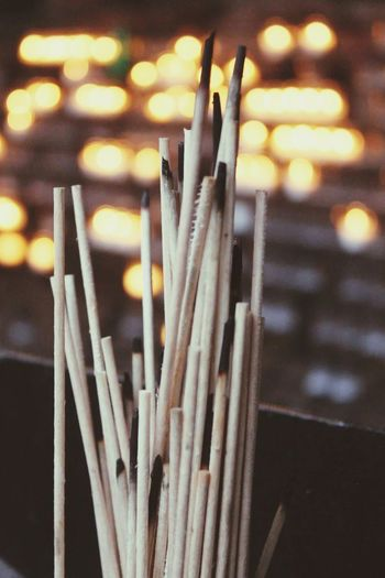 Close-up of burnt incense in church