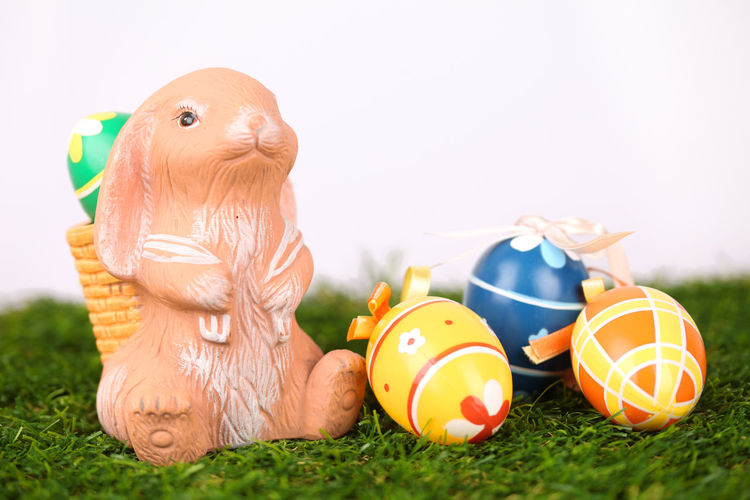 Close-up of toy and easter eggs on green rug