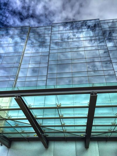 """The Continuum"" Dramatic clouds infinitely reflected in the glass of modern architecture. Glass Glassreflections Reflection Window Reflections Urban Reflections Reflections Architecture_collection Glassarchitecture Achitecture"