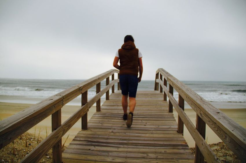 Great memories from Outer Banks, North Carolina. Beach Original Experiences Boardwalk Bridge Buxton Casual Clothing Full Length On The Way Leisure Activity Lifestyles Man Nature Ocean Ocean View People And Places Outer Banks, NC Pier Rear View Run Running Shore The Way Forward Traveling Unrecognizable Person Vacations