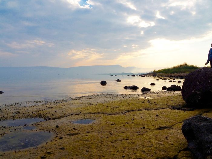 Sky Cloud - Sky Water Scenics - Nature Tranquil Scene Beauty In Nature Tranquility Rock Nature Land Solid Rock - Object Sunset Environment Non-urban Scene Beach Landscape Sea Sea Of Galilee Sundown
