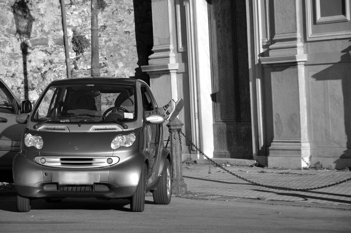 Old-fashioned Outdoors Architecture No People Day Car People Photography Smart Car Point Of View Black And White