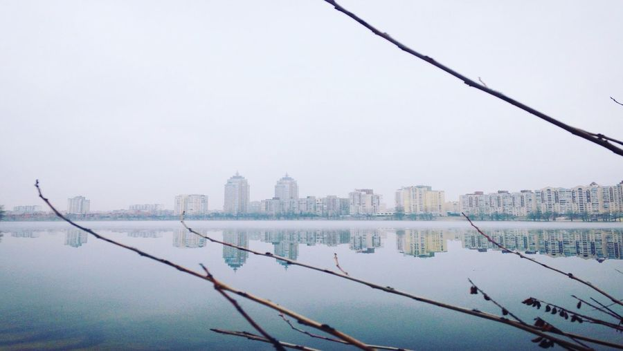 Scenic View Of Lake By City Against Sky
