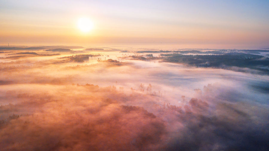 Aerial view of cloudscape over sea during sunset