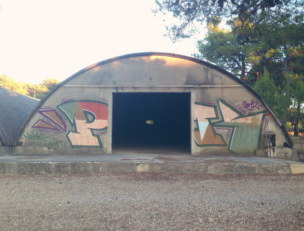 Old abandoned military hangar Abandoned Abandoned Buildings Abandoned Places Arch Architecture Architecture Building Exterior Built Structure Empty Empty Places Façade Graffiti Hangar Military Old Outdoors Round Scary Spooky Storage