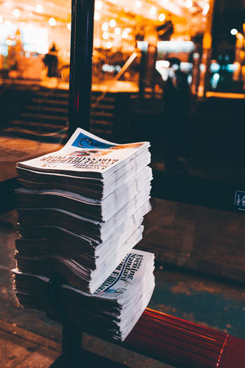 Stack Of Newspapers On Bench