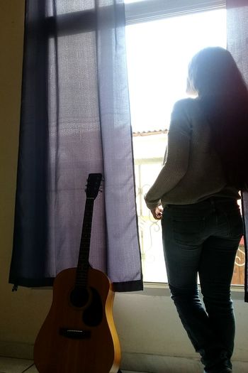 Indoors  Window Standing One Person Guitar Only Women One Woman Only Musician Day Young Women Home Interior Silhouette
