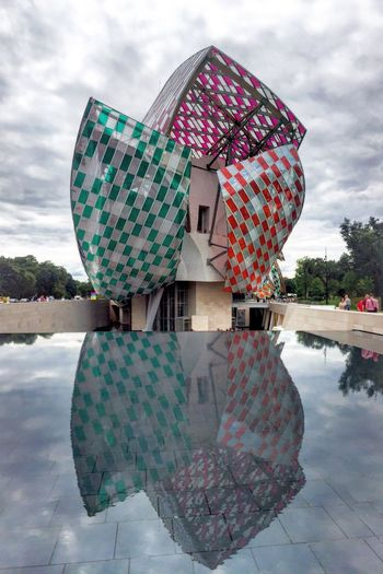 Fondation Louis Vuitton Paris Fondation Louis Vuitton  Frankgehry Architecture Danielburen Installation Boisdeboulogne Jardin De La Climatation Water Reflection Waterreflections  Greysky Clouds Crystal