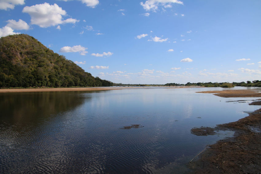 Ruvuma River in Southern Tanzania Blue Blue Sky Cloud - Sky Day Hill Landscape Nature No People Outdoors Reflection Reflections In The Water River Scenics Sky Tranquil Scene Tree Water