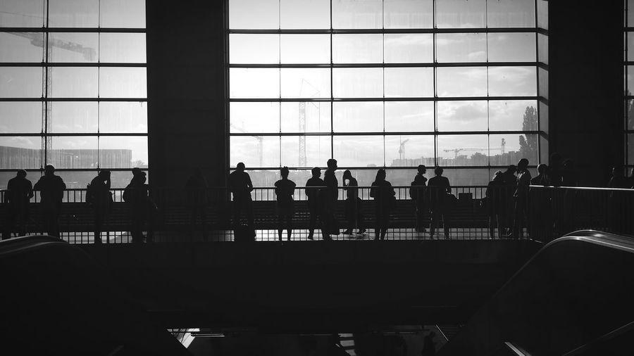 Silhouette people in waiting room at ostkreuz