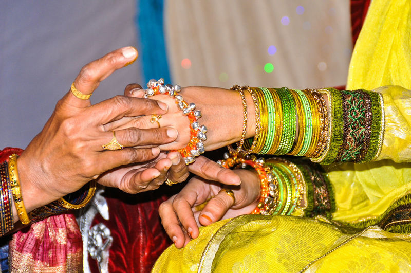 Close-up of womens hands in indian wedding ceremony