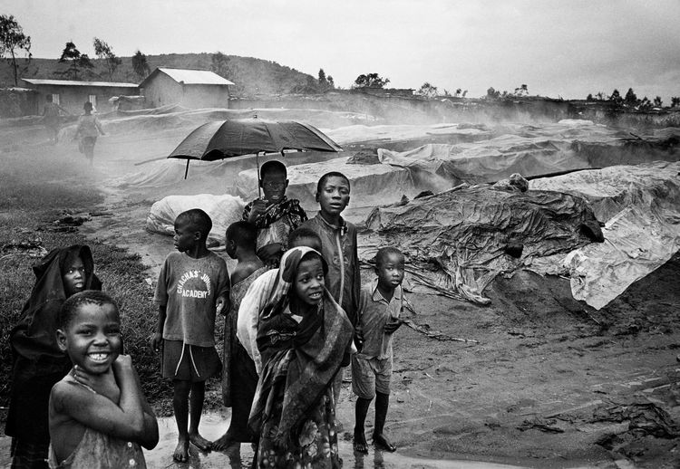 Africa Analogue Photography Blackandwhite Childhood Clouds And Sky Coulds Darwins Nightmare, Victoria Perch Is Filleted In Factories, The Fillet Goes To The World Market And The Fishbones Are Brought To The Near By Villages. Film Photography Fish Dumping Site Fishing Village Leica M6 Leica M6 Film Image Looking At Camera Monsoon Mwanza Outdoors Rain Rainy Season Suffering The Week On EyeEm Togetherness Victoria Perch