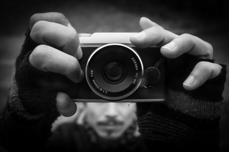 Close-up of man hands holding camera