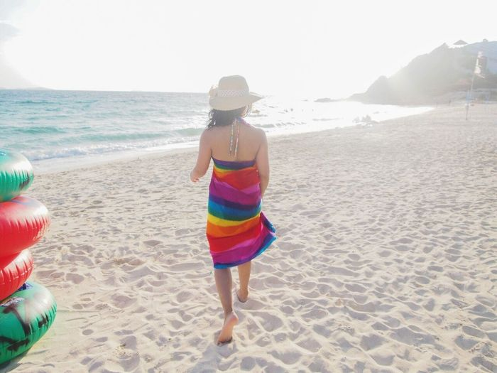 Never look back. Beach Sand Sea Rear View Vacations Full Length Summer One Person Day Leisure Activity People Outdoors Adult Weekend Activities Travel Destinations Nature Childhood Horizon Over Water Only Women Wave Destination Weekend Getaway Journey Relaxation Barefoot