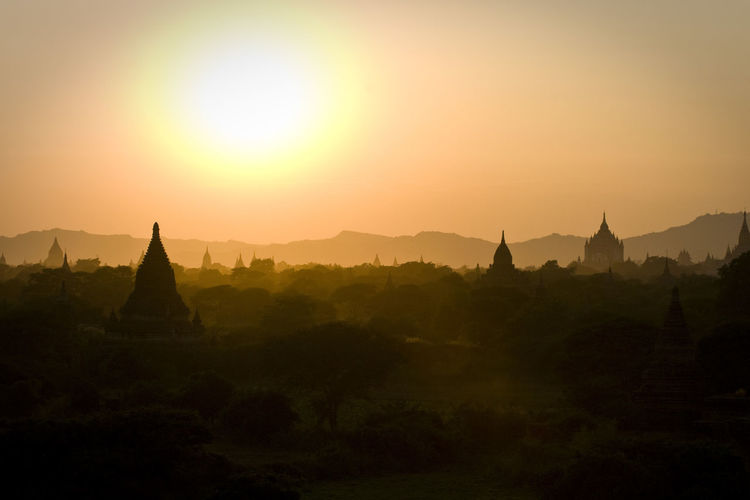 Temples at bagan archaeological zone against sky during sunset