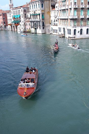 High Angle View People On Boats Sailing In Grand Canal