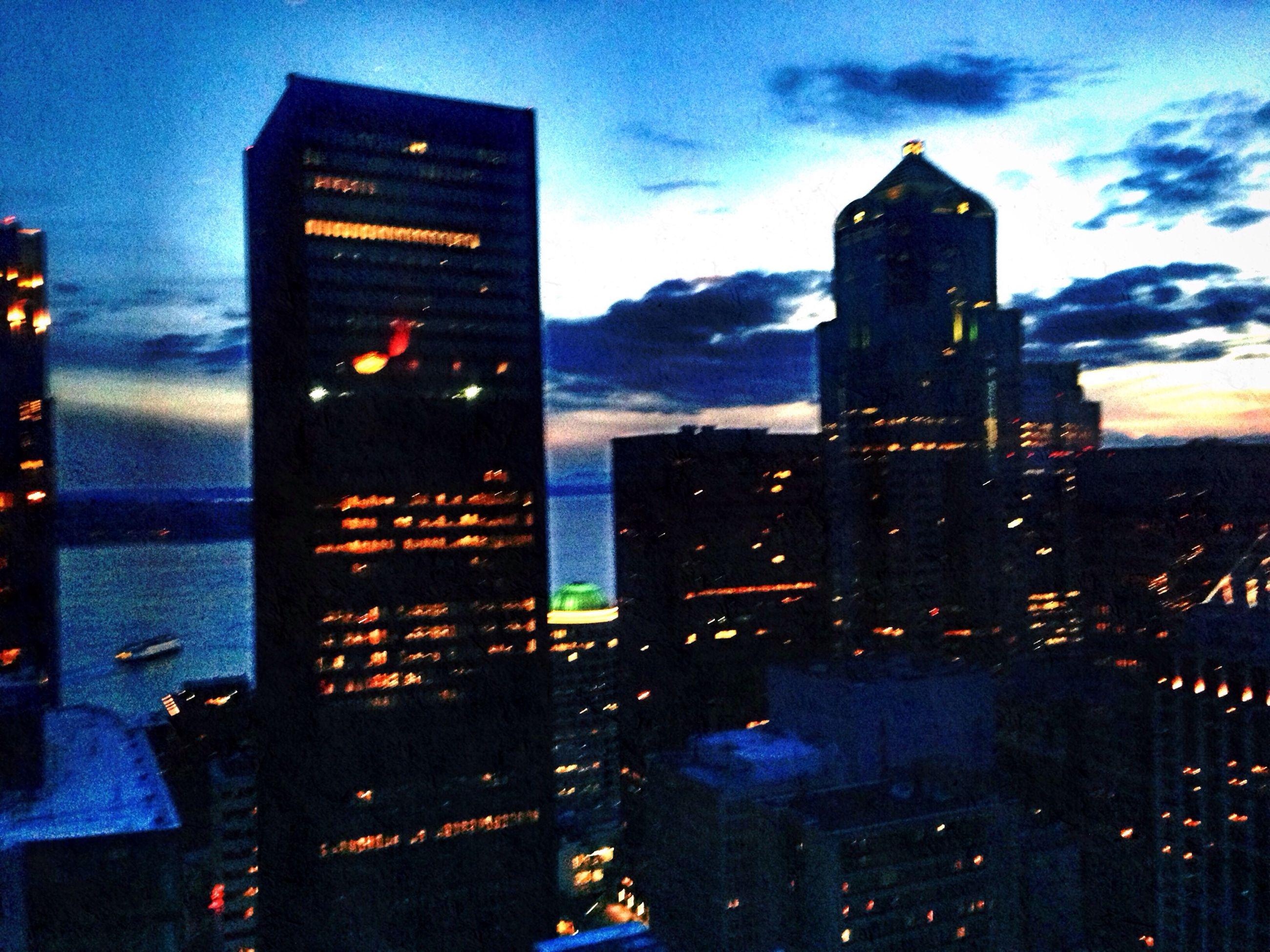 building exterior, architecture, built structure, city, sky, cityscape, building, skyscraper, illuminated, dusk, residential building, tower, city life, cloud - sky, residential structure, weather, office building, season