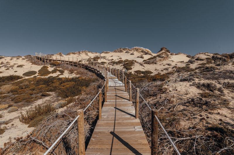 Empty boardwalk at desert