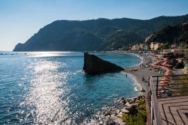 Coastline, beach and sea - Cinque Terre before sunset Bather Bay Of Water Beach Beauty In Nature Before Sunset Cinque Terre Cinqueterre Coastline Gulf Monterosso Al Mare Mountain Nature Outdoors Reflection Rippled Rock Scenics Sea Shore Sunshade Tranquil Scene Tranquility Water Waterfront