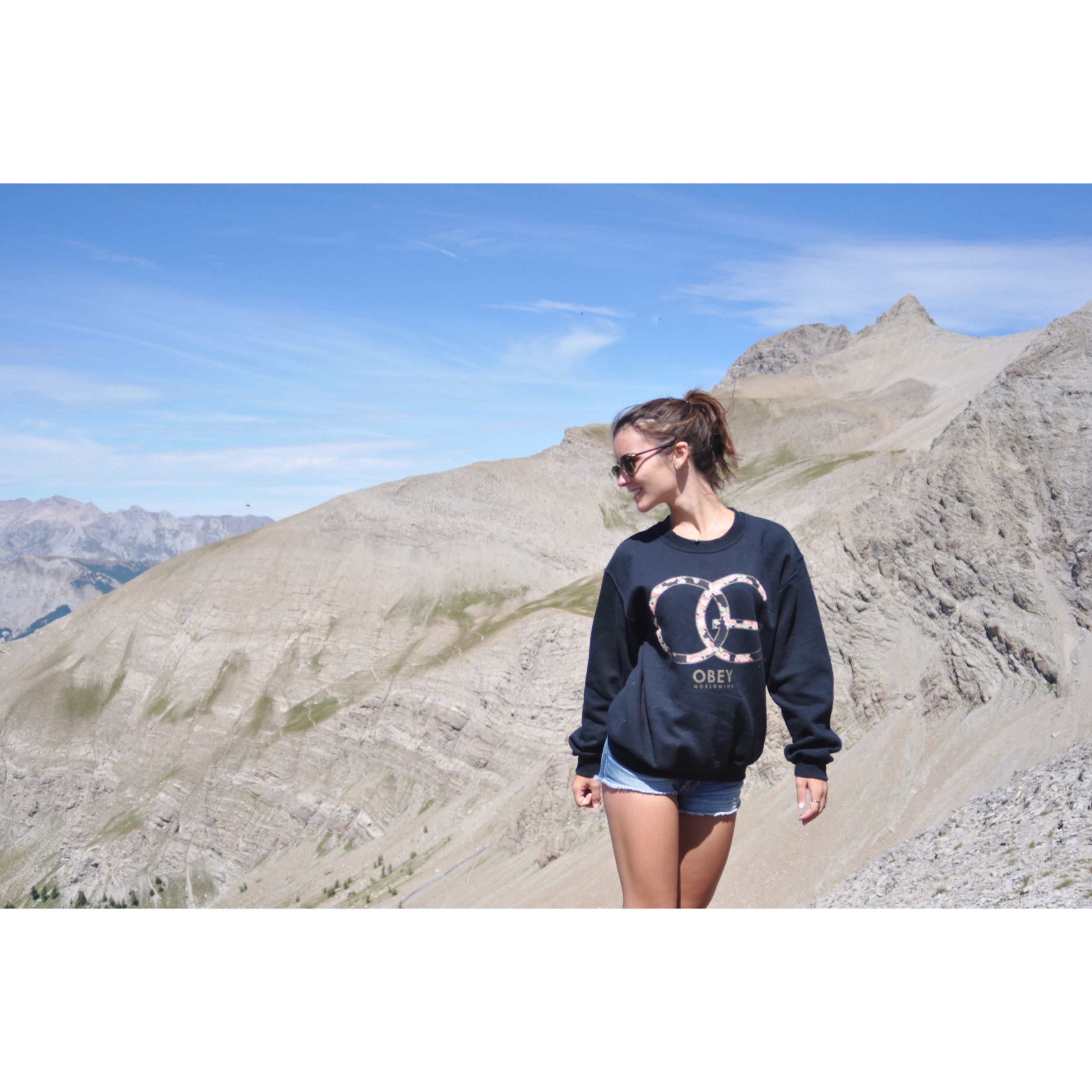young adult, casual clothing, mountain, lifestyles, sky, person, leisure activity, standing, transfer print, portrait, full length, looking at camera, auto post production filter, young women, landscape, tranquil scene, tranquility, scenics