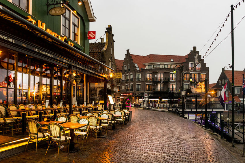 Architecture Building Building Exterior Built Structure Business Cafe Canal Chair City Dusk Illuminated Incidental People Lighting Equipment Nature Restaurant Seat Sidewalk Cafe Sky Street Table Travel Destinations