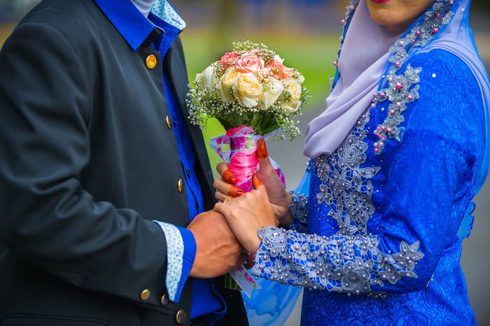 bride hand couple holding colorful bouquet Bonding Bouquet Bride Bridegroom Celebration Celebration Event Ceremony Flower Groom Holding Life Events Love Men Midsection Real People Rose - Flower Togetherness Tradition Traditional Clothing Two People Wedding Wedding Ceremony Wedding Dress Well-dressed Women