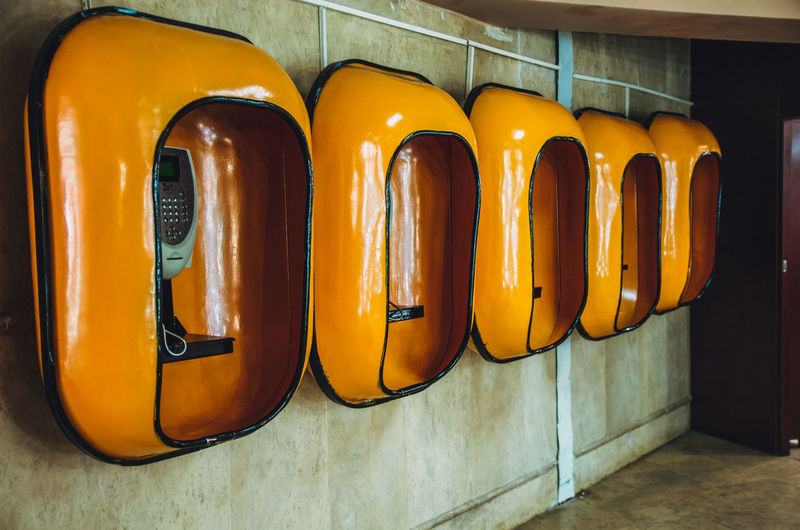 Yellow telephone booths on wall