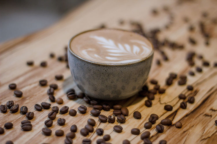 Coffee Coffee - Drink Coffee Cup Coffee Time Coffee Break Food And Drink Indoors  No People Drink Refreshment Roasted Coffee Bean Still Life Close-up Wood - Material Freshness Food Table Frothy Drink Cappuccino Cup Mug Selective Focus Caffeine Latte Non-alcoholic Beverage