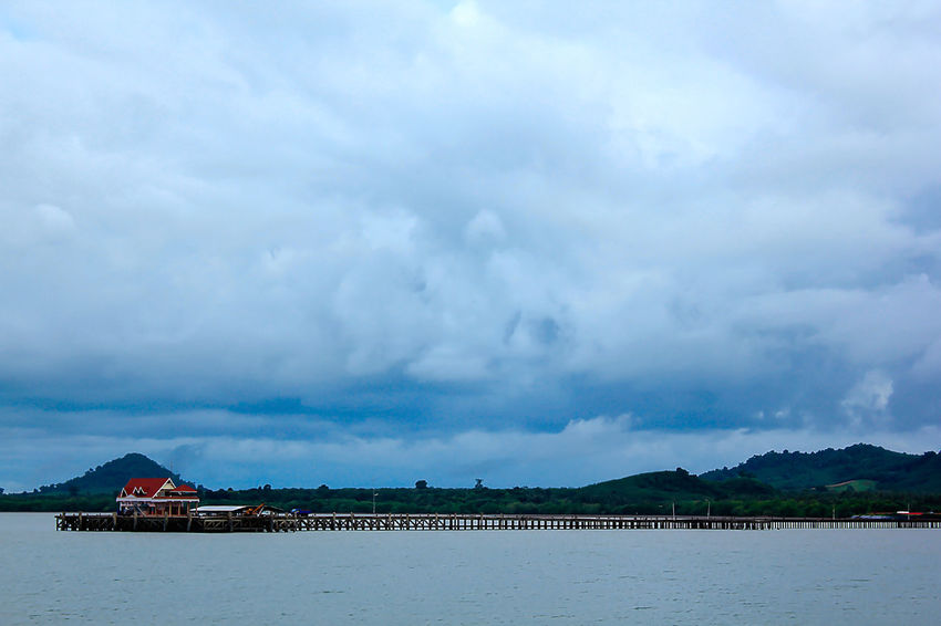 The sky is overcast. Beauty In Nature Cloud - Sky Landscape Sea Mountain Nature Nimbus Nimbus Cloud Nimbus Clouds No People Outdoors Overcast. Scenics - Nature Sea Seascape Sky Sky Is Overcast. Tranquil Scene Tranquility Travel Destinations Water Waterfront