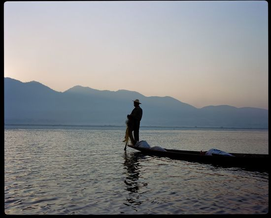 Adult Adults Only Beauty In Nature Burma Day Inle Lake Lake Mountain Mountain Range Nature One Man Only One Person Only Men Outdoors People Scenics Silhouette Sky Sunset Water