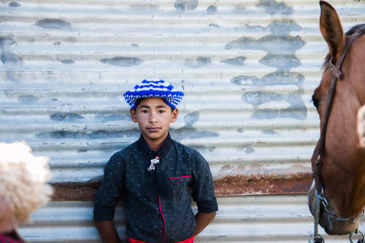 Portrait of young argentinian boy wearing traditional clothing