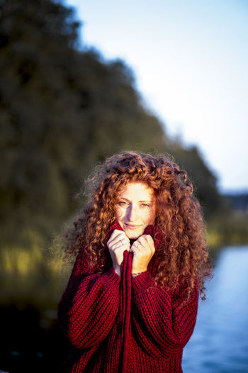 Adult Adults Only Beautiful People Beautiful Woman Beauty Curly Hair Fashion Headshot Human Hair Long Hair Nature One Person One Woman Only One Young Woman Only Only Women Outdoors People Portrait Red Redhead Standing Women Wool Young Adult Young Women