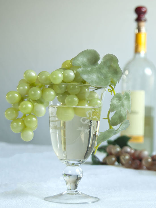 Bunch Of Grapes Centerpiece Close-up Decoration Flower Arrangement Flower Head Focus On Foreground Food And Drink Freshness Fruit Glass - Material Green Color No People Still Life Table Transparent Wine Wine Bottle