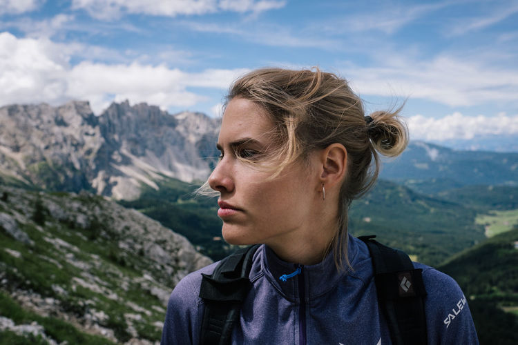 Rosengarten Nature Portrait One Person Leisure Activity Headshot Lifestyles Real People Mountain Young Adult Focus On Foreground Mountain Range Day Beauty In Nature Blond Hair Sky Environment Scenics - Nature Non-urban Scene Hair Outdoors Hairstyle Contemplation