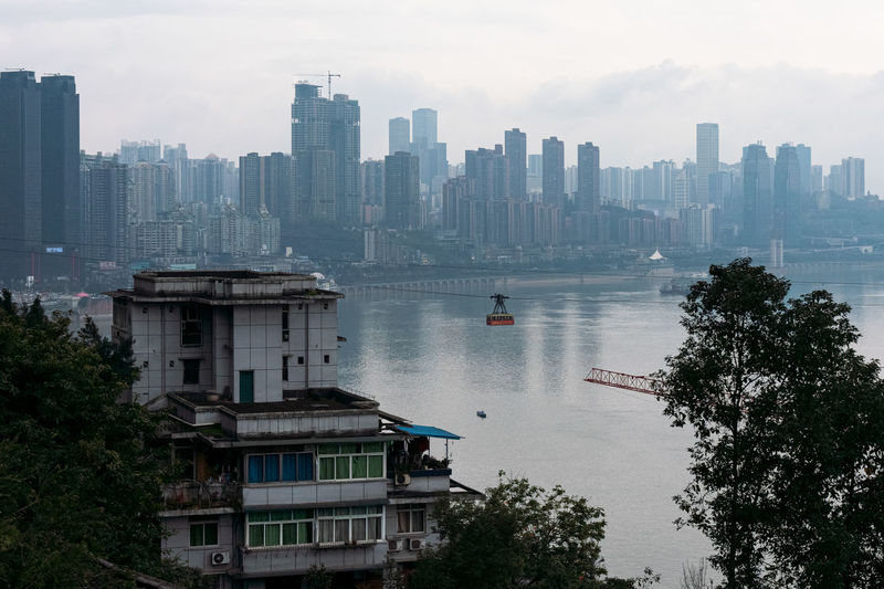 Aerial view of lake by buildings in city