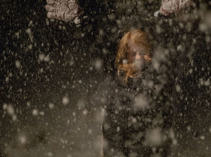A five-year-old girl with red hair throws snow into the air during a blizzard on a winter night. Snow Winter Snowing Cold Temperature One Person Nature Headshot Portrait Tree Snowflake Blizzard Day Outdoors Emotion Storm Selective Focus Extreme Weather Winter Child Childhood Girl Red Hair Throwing  Action Nighttime A New Perspective On Life Holiday Moments Moments Of Happiness