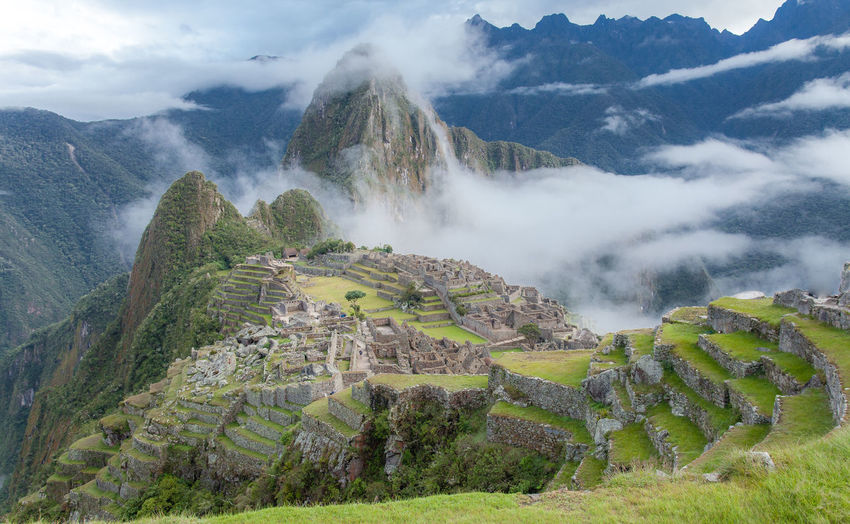 Morning At Machu Picchu Machu Picchu - Peru This Is Latin America Ancient Civilization Beauty In Nature Cloud - Sky Clouds And Sky Day Environment Fog Green Color Idyllic Inca Ruins Land Landscape Mountain Mountain Range Nature Non-urban Scene Outdoors Plant Scenics - Nature Sky Tranquil Scene Tranquility The Traveler - 2018 EyeEm Awards